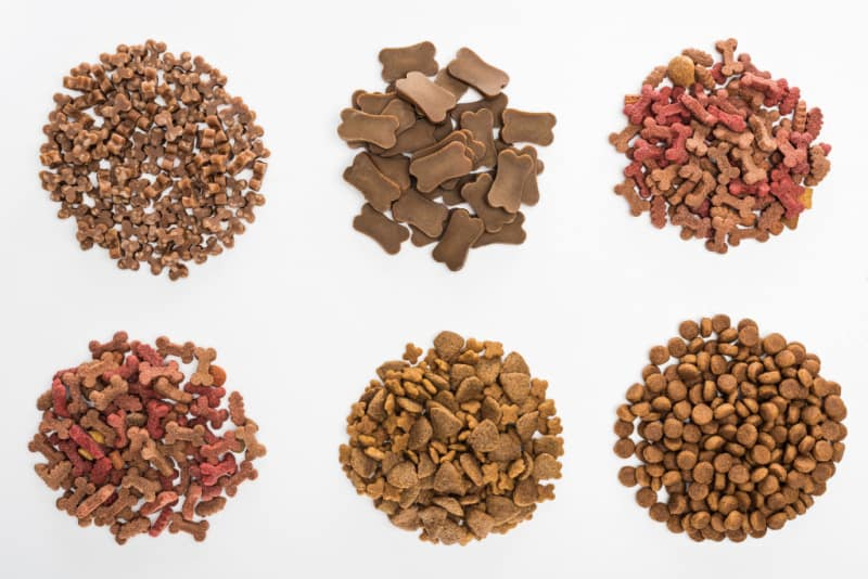 Top view of assorted dry pet food in piles